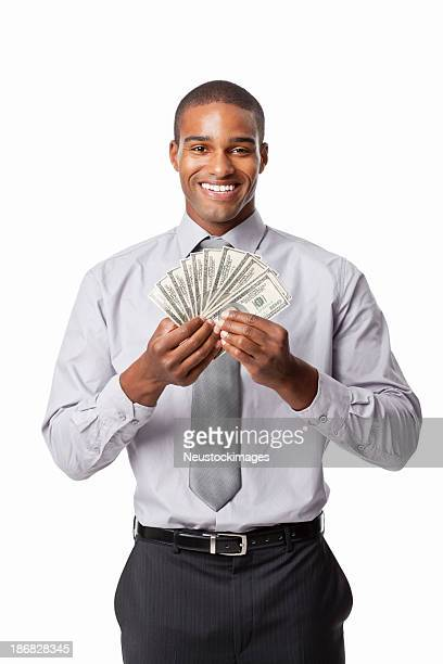 businessman showing off money - isolated - bringing home the bacon stock photos and pictures