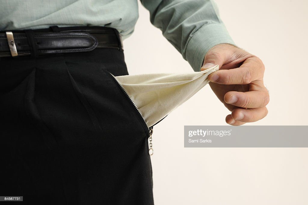Businessman showing out an empty pant's pocket : Stock Photo