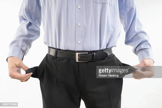 Businessman showing out his empty pockets, Bavaria, Germany