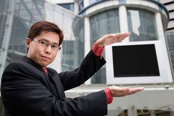 Businessman showing outdoor screen
