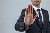 Businessman showing stop with hand
