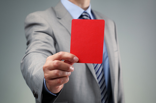 Businessman showing the red card 500751647