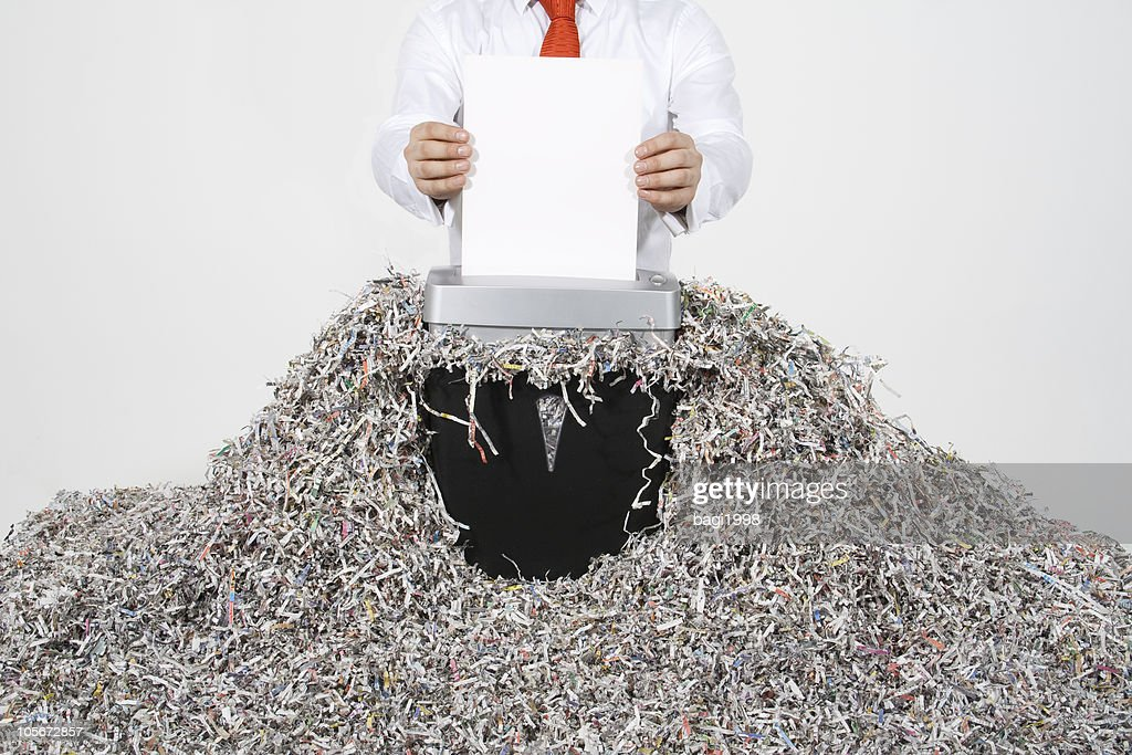 Businessman Shredding Documents : Stock Photo