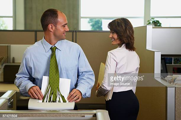 Businessman shredding his tie whilst looking away