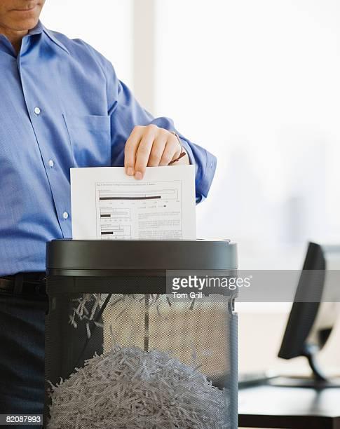 Businessman Shredding Paper