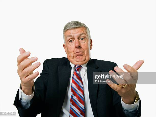 A businessman shrugging