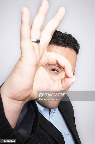 Businessman signals okay with his fingers