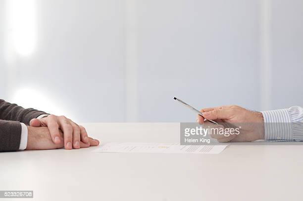 businessman signing a contract - contract stock pictures, royalty-free photos & images