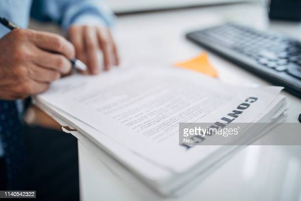 Businessman signing contract in office