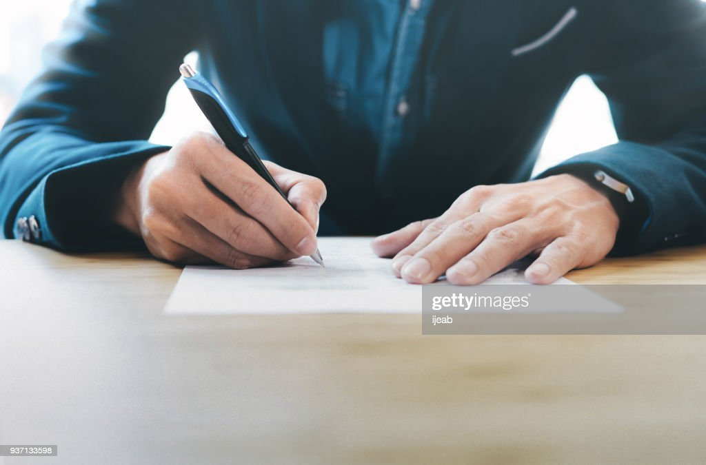 Businessman signing contract making a deal. : Stock Photo