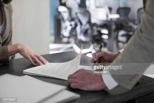 Businessman signing document