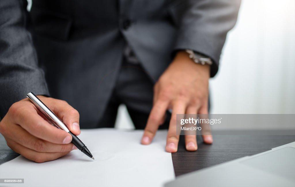 Businessman signing documents : Stock Photo