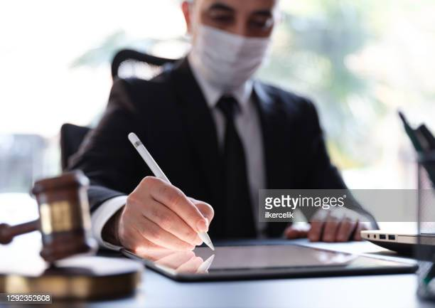 businessman signing electronic legal document on digital tablet in pandemic period - businesswear stock pictures, royalty-free photos & images