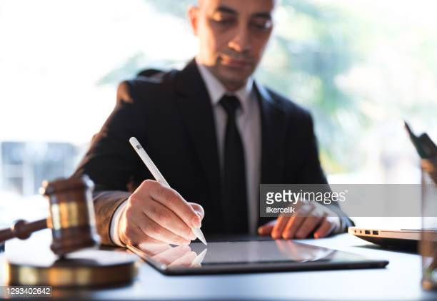 businessman signing electronic legal document on digital tablet - legal system stock pictures, royalty-free photos & images
