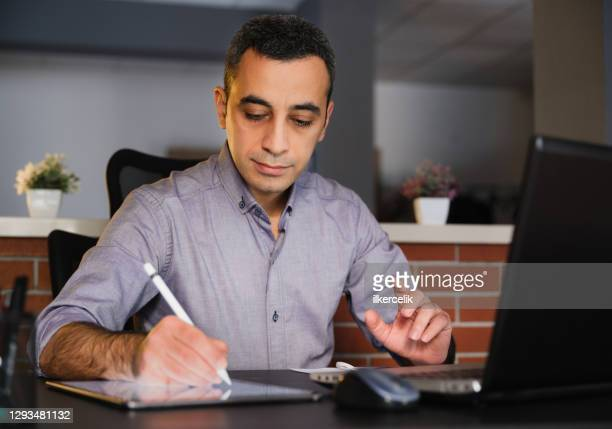 businessman signing electronic legal document on digital tablet - agreement stock pictures, royalty-free photos & images