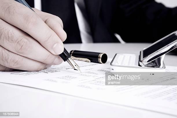 Businessman Signing Form
