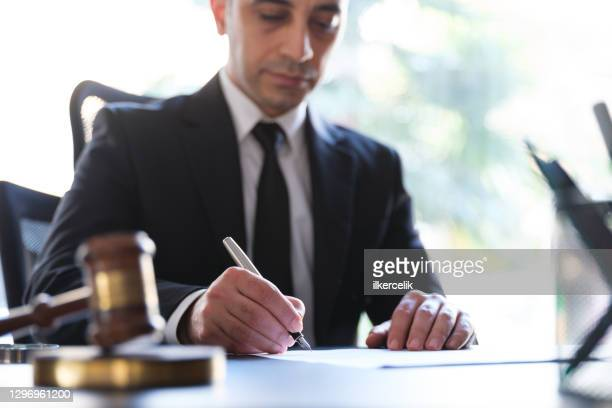 businessman signing legal paper in office - condition stock pictures, royalty-free photos & images