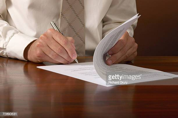 businessman signing papers on desk, close up, close-up - agreement stock pictures, royalty-free photos & images