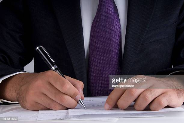 businessman signing papers on desk, close up - purple suit stock pictures, royalty-free photos & images