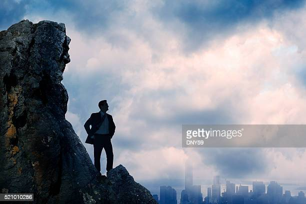 Businessman Silhouetted As He Confidently Looks Over City