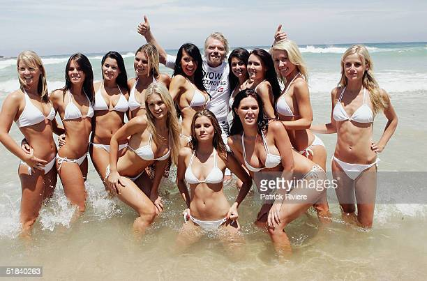 Businessman Sir Richard Branson poses in the surf with models on Bondi Beach during his visit to launch his new Virgin Atlantic airline venture...