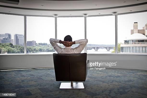 Businessman sitting alone in open room