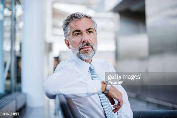 businessman sitting and thinking - shirt and tie stock pictures, royalty-free photos & images