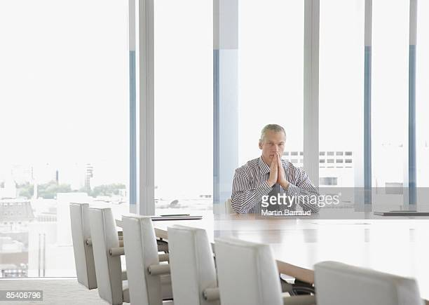 Businessman sitting at conference table
