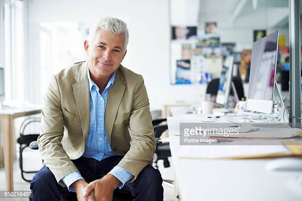 Businessman sitting at desk in creative office