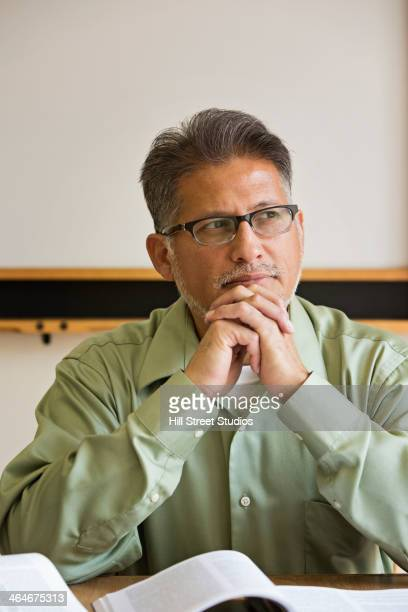 businessman sitting at desk in office - tensed idaho stock photos and pictures