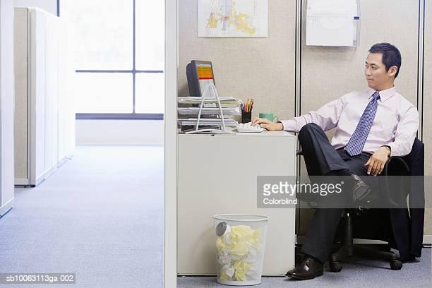 Businessman sitting at desk using computer