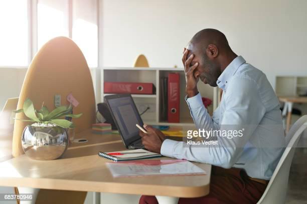 Businessman sitting at office desk