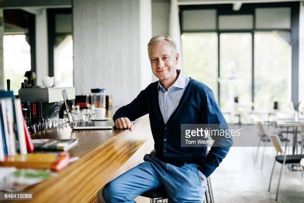 Businessman Sitting At Restaurant Bar Working On laptop