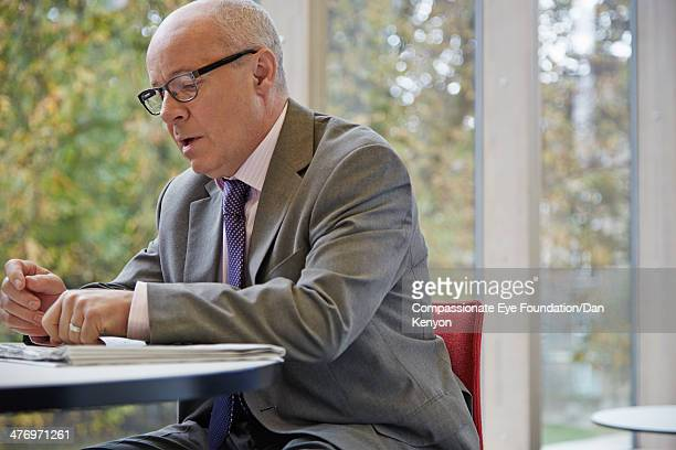Businessman sitting at table in offce