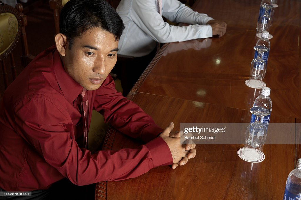 Businessman sitting at table : Photo