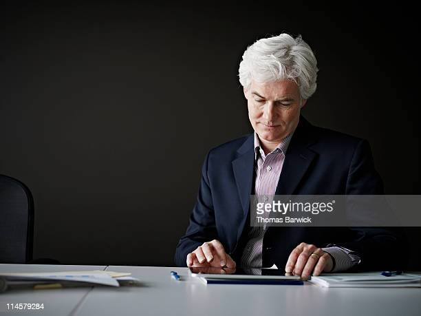 Businessman sitting at table working