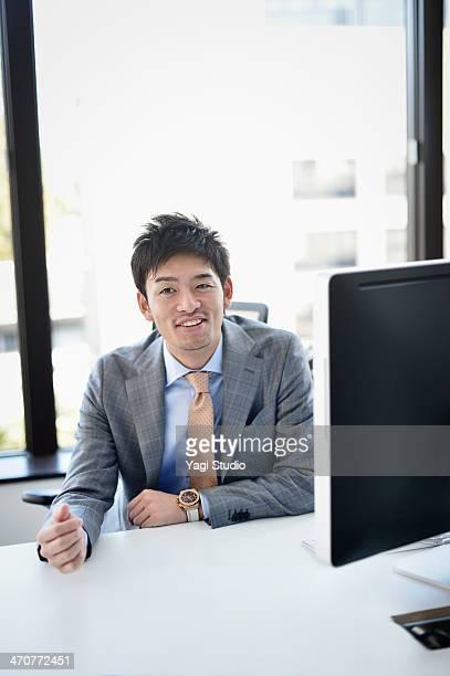Businessman sitting at workstation