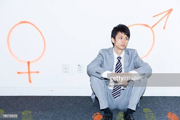Businessman Sitting Before Figurative s