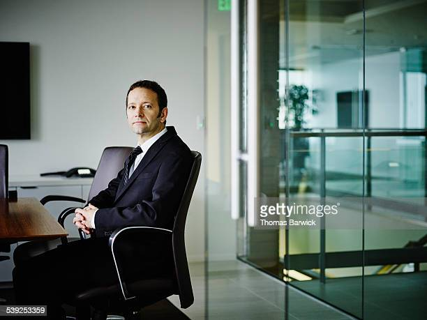 Businessman sitting conference room waiting