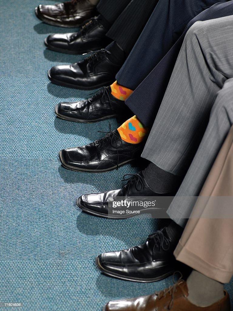 Businessman sitting in a row : Bildbanksbilder