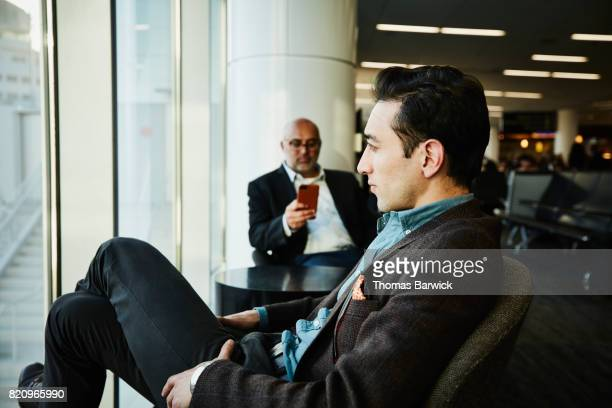 Businessman sitting in airport waiting for flight