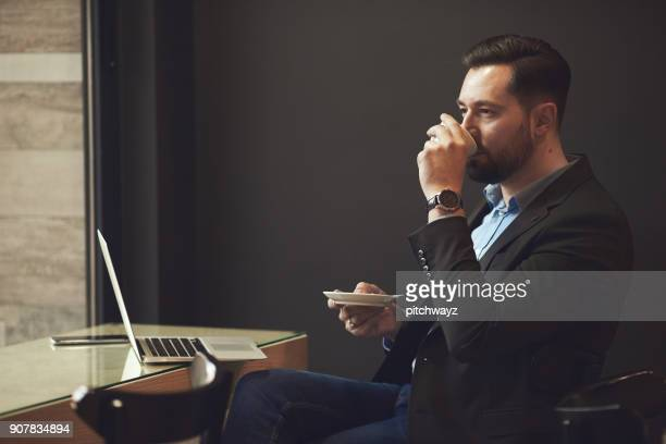 Businessman sitting in cafe.
