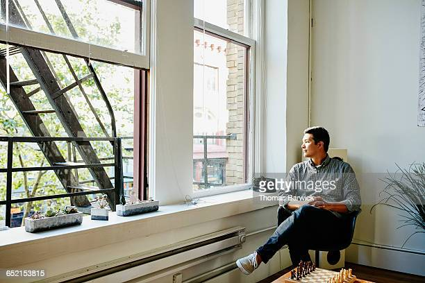 Businessman sitting in chair in startup office
