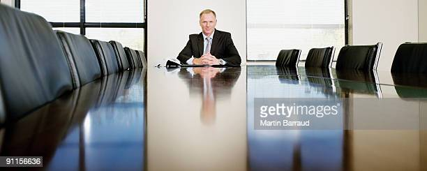 businessman sitting in conference room - one man only stock pictures, royalty-free photos & images