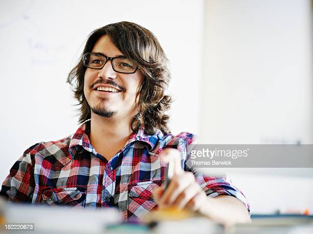 Businessman sitting in discussion at workstation