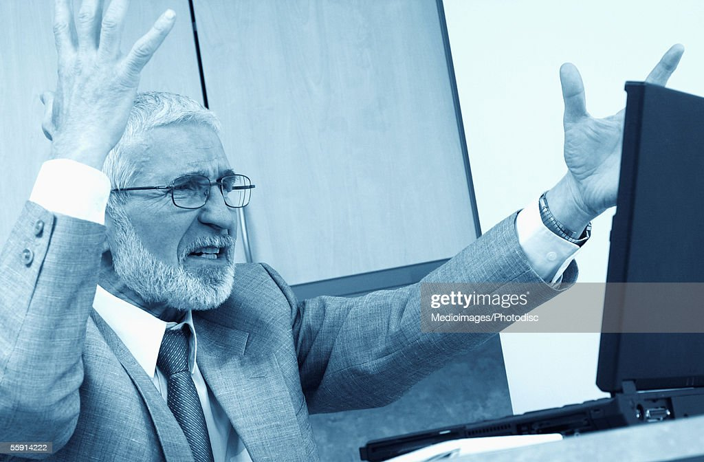 Businessman sitting in front of a laptop : Stock Photo