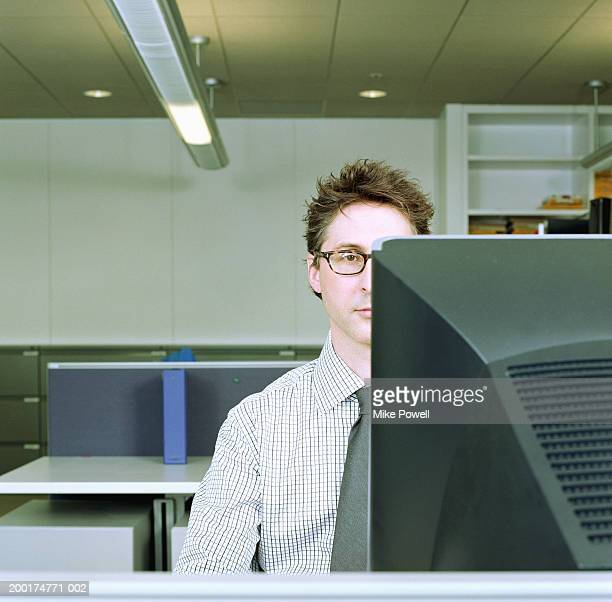 Businessman sitting in front of computer monitor