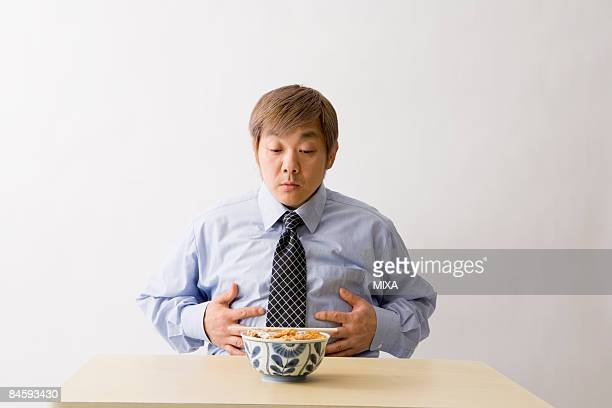 Businessman sitting in front of food