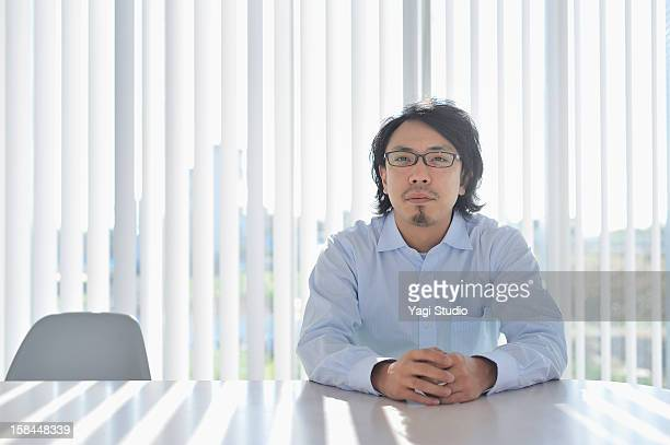 Businessman sitting in meeting desk