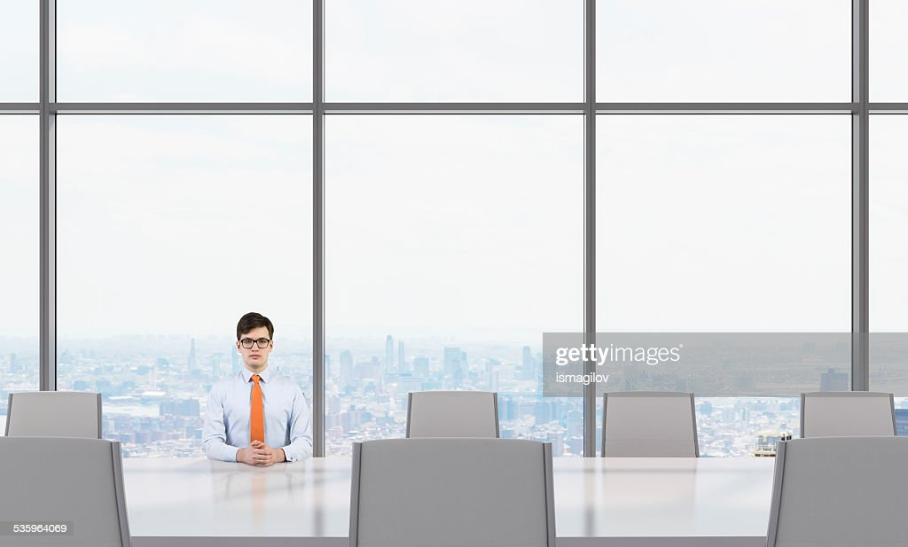businessman sitting in office : Stock Photo